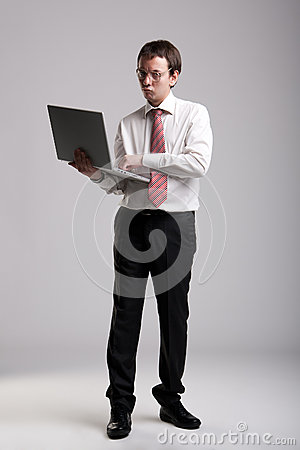 Nerdy businessman holding a laptop