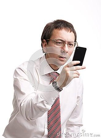 Nerdy businessman holding a smartphone