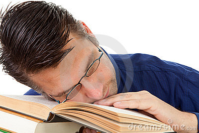 Nerdy geek fall asleep on books