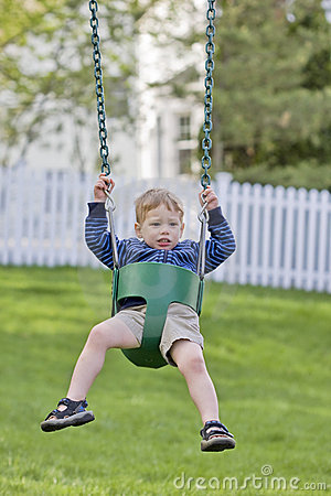 Nervous boy on swing