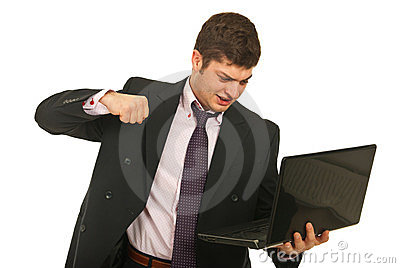 Nervous business man fist  laptop