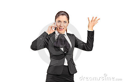 A nervous businesswoman shouting on a mobile phone
