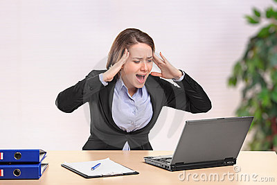 Nervous businesswoman yelling to a laptop