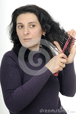 Nervous female brushing hair