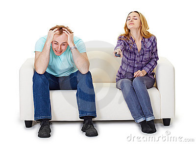 Nervous husband and wife sitting on couch