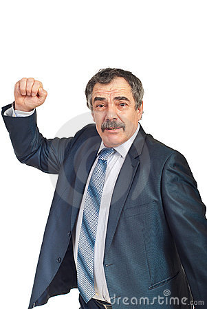 Nervous mature businessman showing fist