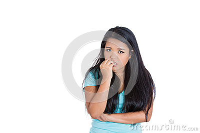 A nervous teenager biting her nails