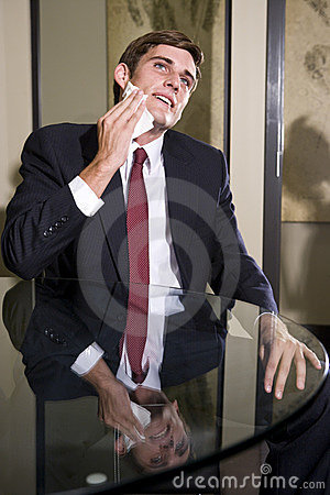 Nervous young businessman in suit sweating