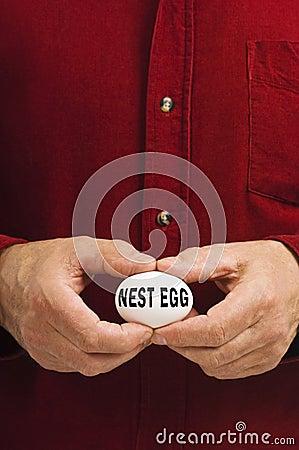 Free NEST EGG Written On Egg Held By Man Stock Photos - 14167863