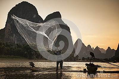 Net and fishing with cormorants on the river Lijiang Editorial Stock Photo