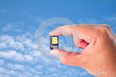 Net Sim card In a hand on blue sky