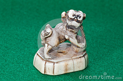 Netsuke - Ivory carving of Shishi