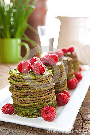 Nettle pancakes with raspberries