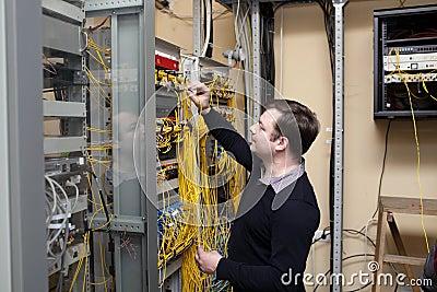 Technician Working In Server Room Stock Photos - Image: 33894273