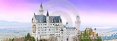 Neuschwanstein Castle in Germany at dusk Stock Photo