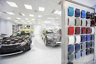 New black cars stand in car shop