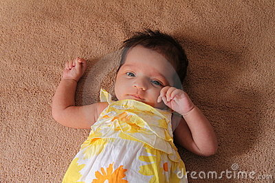 New born asian baby girl in cute dress