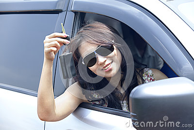New car owner showing off key