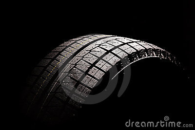 New car tyre on a black background