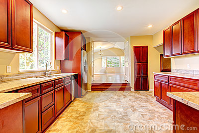 Kitchen Appliances on New Cherry Wood Kitchen With Stinless Steal Appliances  Royalty Free