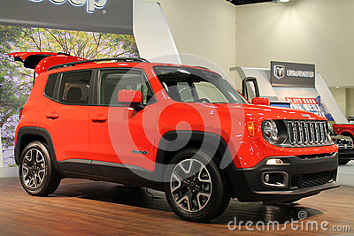 new 2015 jeep renegade small suv on display on turntable jeep stand. Cars Review. Best American Auto & Cars Review