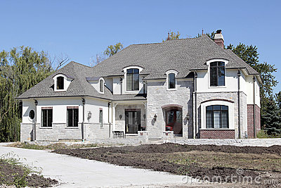 New construction home with unfinished landscaping