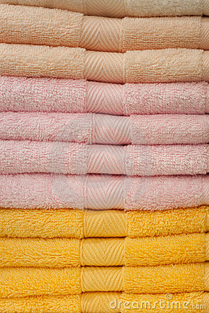 New fluffy towels on a rack in shop