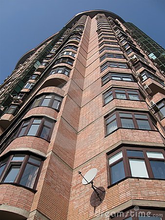 New high building, red brick, satellite plates