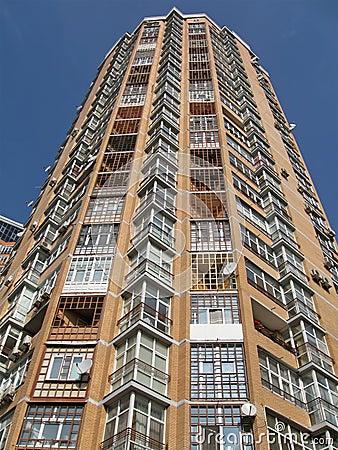 New high skyscraper, red brick, satellite plates