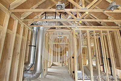 New home construction framed with wood studs stock photos for Plumbing for new construction