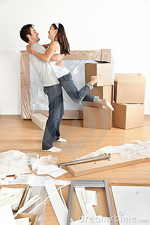 Free New Home : Happy Young Moving Couple Stock Photography - 22045432
