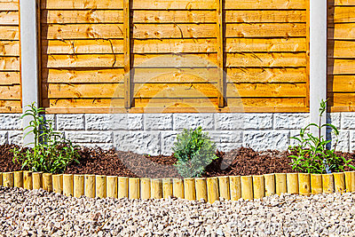 New landscaped wood chip garden border
