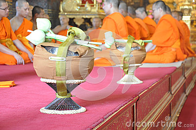 A new monk lights incense during a Buddhist ordination ceremony Editorial Photo