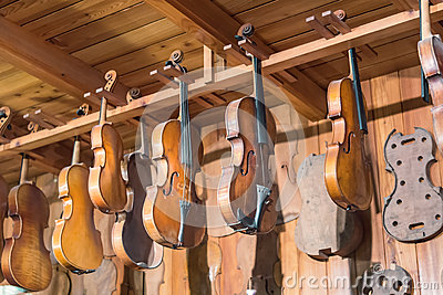 New and old violins in workshop