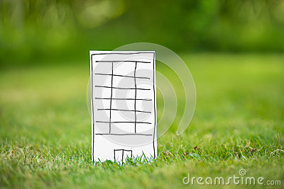 New paper highrise tower in grass