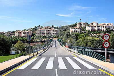 New road and bridge over golf course in Spain