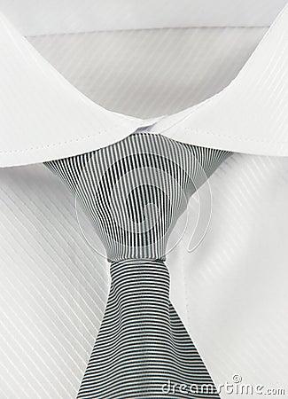 New shirt with a grey striped necktie