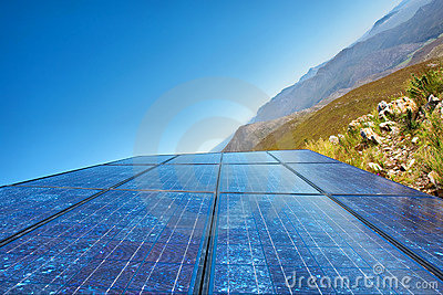 New sky  - blue solar cells and awesome mountain