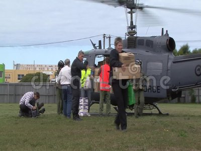 New supplies. CHRISTCHURCH, NEW ZEALAND, FEBRUARY 23, 2011 - A NZRAF helicopter delivers emergency food supplies to a school at East Brighton after a 6. 4 stock footage