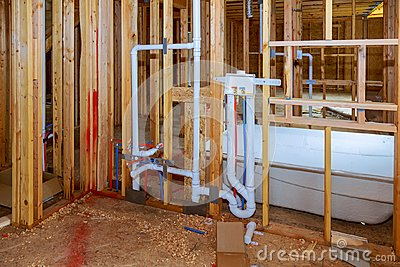 New under construction bathroom interior with interior framing of new house under construction Stock Photo