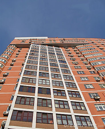 new urban high building, red brown brick, windows