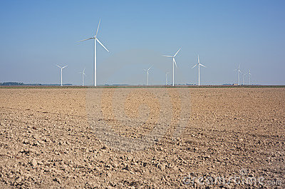 New windmills in a field.