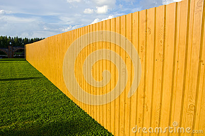 New wooden fence in farm