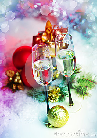 Free New Year And Christmas Celebration .Two Champagne Glasses In Hol Royalty Free Stock Photography - 28266537