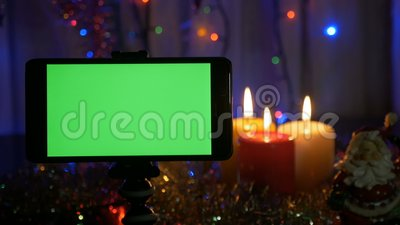 new years background in the foreground a smartphone with a green screen a great opportunity to add your greeting stock footage video of present