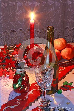 New Year s setting with wine, glass, tangerines