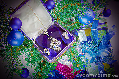 On a New Year tree a gift - jewelry