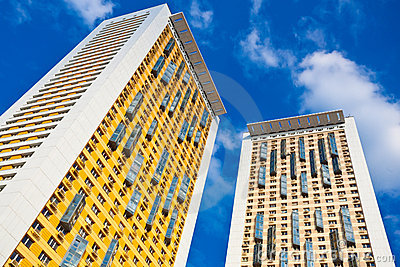 New yellow dwelling towers with balconies