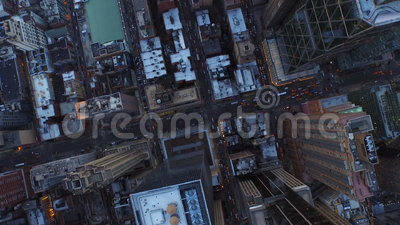 New York City Aerial. V13 Vertical shot looking down over Midtown Manhattan heading west just after sunset