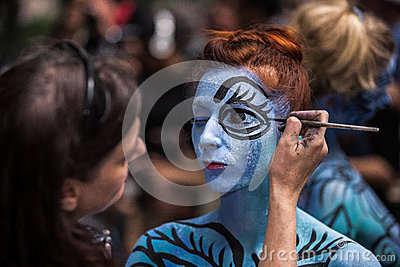 NEW YORK - JULY 26: Nude models, artists take to New York City streets during first official Body Painting Event